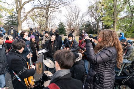 People gathered around Strawberry Field Imagine mosaic in Central Park to remember John Lennon 40 years after his death. John Lennon was killed 40 years on this day of December 8. Fans laid flower and lit candles at Strawberry Field in Central park around Imagine mosaic to remember his songs and legacy, some of them sang songs written by John.