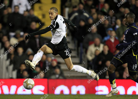 Stock Photo of Bobby Zamora of Fulham when one on one with the goalkeeper shoots wide chased by Sebastian Bassong