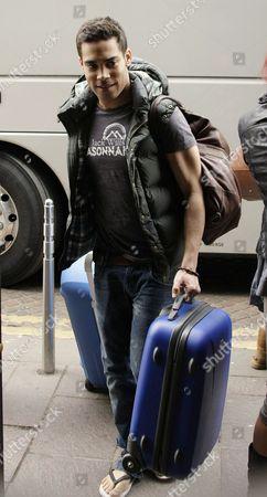 Danyl Johnson bringing his luggage in