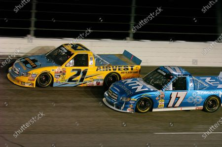 Darlington 200, Darlington,S C. 12 November 2004 Hank parker,Jr. and David Reutimann (17) race together. -F Peirce Williams 2004 LAT Photographic