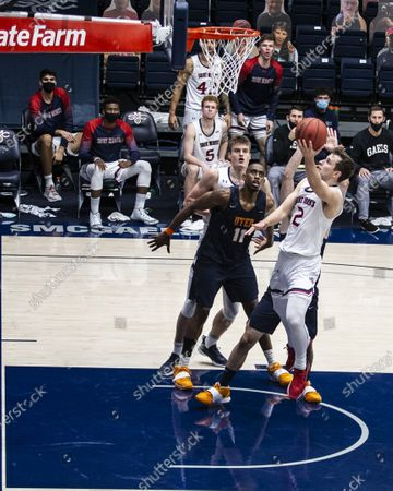 Stock Picture of Moraga, CA U.S.A. St. Mary's Gaels guard Tommy Kuhse #12 drives to the basket St. Mary's Gaels guard Quinn Clinton #2 brings the ball up court during the NCAA Men's Basketball game between UTEP Miners and the Saint Mary's Gaels 73-61 win win at McKeon Pavilion Moraga Calif. Thurman James / CSM