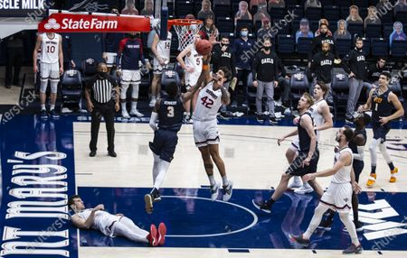 Stock Picture of Moraga, CA U.S.A. St. Mary's Gaels forward Dan Fotu #42 block the shot of guard Keonte Kennedy #3 UTEP Miners during the NCAA Men's Basketball game between UTEP Miners and the Saint Mary's Gaels 73-61 win win at McKeon Pavilion Moraga Calif. Thurman James / CSM
