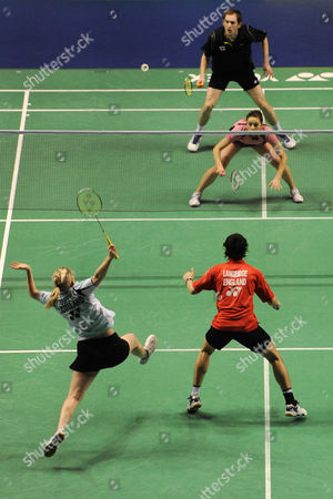 Stock Photo of Jillie Cooper of Scotland makes a return during the mixed doubles match with her partner Chris Langridge of England, playing against Andrew Ellis of England and Emma Mason of Scotland