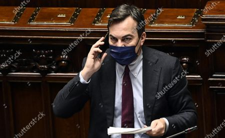Stock Photo of Minister of European Affairs Vincenzo Amendola uses his smartphone as Italian Prime Minister Giuseppe Conte delivers a speech at the Chamber of Deputies on the upcoming European Council meeting, Rome, Italy, 09 December 2020.