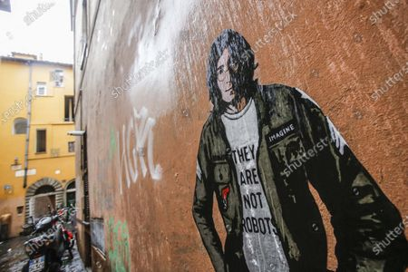 Stock Photo of The mural depicting John Lennon, posted by street artist Harry Greb in Via dell Arco di Santa Margherita, near Campo de Fiori, on the occasion of the fortieth anniversary of his assassination