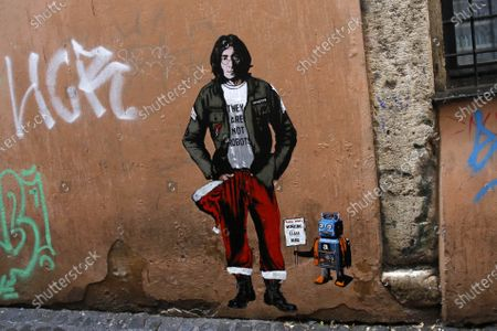 Stock Image of The mural depicting John Lennon, posted by street artist Harry Greb in Via dell Arco di Santa Margherita, near Campo de Fiori, on the occasion of the fortieth anniversary of his assassination