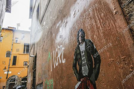 Stock Picture of The mural depicting John Lennon, posted by street artist Harry Greb in Via dell Arco di Santa Margherita, near Campo de Fiori, on the occasion of the fortieth anniversary of his assassination