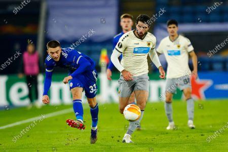 Luke Thomas of Leicester City plays the ball back under pressure from Karim Ansarifard of AEK Athens; King Power Stadium, Leicester, Midlands, England; UEFA Europa League Football, Leicester City versus AEK Athens.