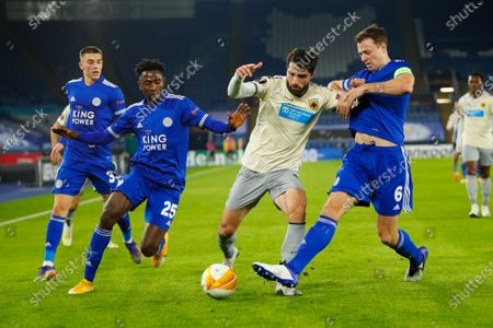 Karim Ansarifard of AEK Athens holds off Wilfred Ndidi and Jonny Evans of Leicester City; King Power Stadium, Leicester, Midlands, England; UEFA Europa League Football, Leicester City versus AEK Athens.