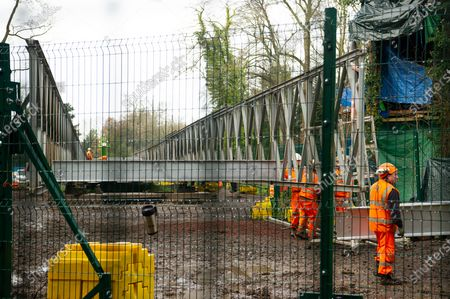 Having already destroyed a big area of woodland, HS2 have now moved into place a temporary access bridge across the River Colne in Denham Country Park to enable heavy machinery into the irreplaceable wet woodlands and SSSI. This is following a huge HS2 and Police operation yesterday when eco warrior Dan Hooper known as Swampy, was removed by Police climbers out of a 30 feet high bamboo structure in the River Colne as he tried to stopped construction of the bridge for a day and a half. HS2 Rebillion and environmental activists are living in tree houses high in ancient trees next to the bridge trying to save them from the destructive chain saws of HS2 Ltd
