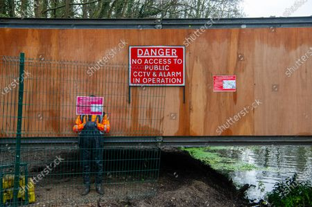 Stock Image of Having already destroyed a big area of woodland, HS2 have now moved into place a temporary access bridge across the River Colne in Denham Country Park to enable heavy machinery into the irreplaceable wet woodlands and SSSI. This is following a huge HS2 and Police operation yesterday when eco warrior Dan Hooper known as Swampy, was removed by Police climbers out of a 30 feet high bamboo structure in the River Colne as he tried to stopped construction of the bridge for a day and a half. HS2 Rebillion and environmental activists are living in tree houses high in ancient trees next to the bridge trying to save them from the destructive chain saws of HS2 Ltd