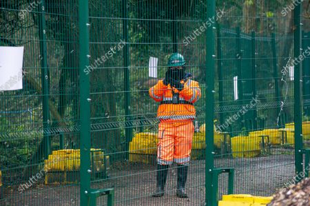 """HS2 security continually film working members of the press for """"profiling reasons"""" from behind their security fences in the HS2 compound. Having already destroyed a big area of woodland, HS2 have now moved into place a temporary access bridge across the River Colne in Denham Country Park to enable heavy machinery into the irreplaceable wet woodlands and SSSI. HS2 Rebillion and environmental activists are living in tree houses high in ancient trees next to the bridge trying to save them from the destructive chain saws of HS2 Ltd"""