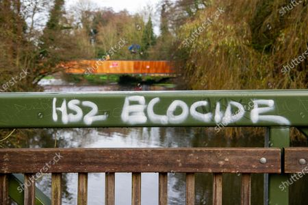 HS2 ecocide graffiti. Having already destroyed a big area of woodland, HS2 have now moved into place a temporary access bridge across the River Colne in Denham Country Park to enable heavy machinery into the irreplaceable wet woodlands and SSSI. This is following a huge HS2 and Police operation yesterday when eco warrior Dan Hooper known as Swampy, was removed by Police climbers out of a 30 feet high bamboo structure in the River Colne as he tried to stopped construction of the bridge for a day and a half. HS2 Rebillion and environmental activists are living in tree houses high in ancient trees next to the bridge trying to save them from the destructive chain saws of HS2 Ltd