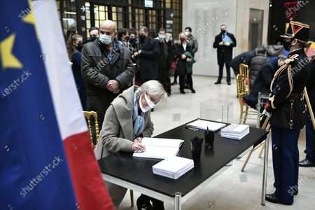 French Junior minister for Disabled people Sophie Cluzel (C) signs the guest book for late former French President Valery Giscard d'Estaing at the Musee d'Orsay in Paris, France, 09 December 2020 on the national day of mourning for the former president. Valery Giscard d'Estaing died from Covid-19 aged 94, surrounded by his family on 02 December at the family estate. Giscard governed for a single seven-year term from 1974 to 1981.