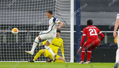 Carlos Vinicius of Tottenham Hotspur  scores the opening goal after Gareth Bale of Tottenham Hotspur's free kick was saved by Alireza Beiranvand of Royal Antwerp