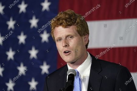 "Rep. Joe Kennedy III speaks outside his campaign headquarters in Watertown, Mass. Retiring Rep. Joe Kennedy III has used his farewell speech from Congress to deride the ""great lie of our times"" that the government lacks the resources and will to help people in need. The Massachusetts Democrat says the real problem is greed, not scarcity"