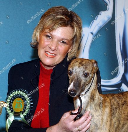 Editorial picture of Lynn Yacoby-wright With Crufts Winner Deedee. Even Their Owners Would Admit They Are Far From Being The Most Glamorous Members Of The Canine World. But Last Night Whippets Were Most Definitely The Top Dog After One Was Named Champion At Crufts. Four-