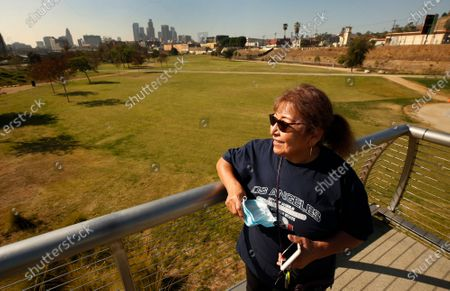 """Xochitl Manzanilla, 78, a nearby resident who serves on a housing and development council describes standing on the pedestrian bridge overlooking the Los Angeles State Historic Park as her """"Titanic Moment."""" A company funded by former Dodgers owner Frank McCourt has proposed a $125 million gondola lift that would fly customers over Los Angeles State Historic Park from Union Station to Dodger Stadium and activists are weighing in. Parents with children and local residents savored the grand opening of the new park in 2017 sandwiched between Chinatown and the L.A. River. Los Angeles State Historic Park, about a 10-minute walk from City Hall, has blossomed into a popular 32-acre urban oasis. Los Angeles State Historic Park on Thursday, Nov. 19, 2020 in Los Angeles, CA. (Al Seib / Los Angeles Times"""