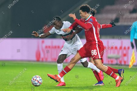 Midtjylland's Pione Sisto (L) in action against Liverpool's Trent Alexander-Arnold (R) during the UEFA Champions League group D soccer match between FC Midtjylland and Liverpool FC in Herning, Denmark, 09 December 2020.