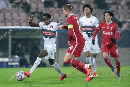 Midtjylland's Pione Sisto (L) in action against Liverpool players Jordan Henderson (C) and Takumi Minamino (R) during the UEFA Champions League group D soccer match between FC Midtjylland and Liverpool FC in Herning, Denmark, 09 December 2020.