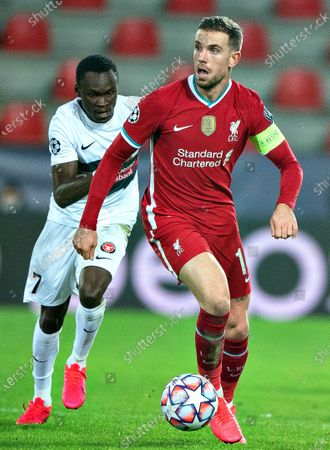 Stock Picture of Liverpool's Jordan Henderson (R) in action against Midtjylland's Pione Sisto (L) during the UEFA Champions League group D soccer match between FC Midtjylland and Liverpool FC in Herning, Denmark, 09 December 2020.