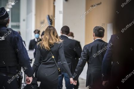Stock Picture of Former French president Nicolas Sarkozy (R) and his wife Carla Bruni Sarkozy (L) exit the courtroom during his trial on corruption charges in the so-called 'wiretapping affair' in Paris, France, 09 December 2020. In 2013, Nicolas Sarkozy was using a false name, Paul Bismuth, to make phone calls to call his lawyer, Thierry Herzog, about the decision that the Court of Cassation was about to take regarding the seizure of presidential diaries in a separate case. The trial is due to run from 23 November to 10 December.