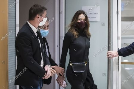 Former French president Nicolas Sarkozy (2L) and his wife Carla Bruni Sarkozy (R) exit the courtroom during his trial on corruption charges in the so-called 'wiretapping affair' in Paris, France, 09 December 2020. In 2013, Nicolas Sarkozy was using a false name, Paul Bismuth, to make phone calls to call his lawyer, Thierry Herzog, about the decision that the Court of Cassation was about to take regarding the seizure of presidential diaries in a separate case. The trial is due to run from 23 November to 10 December.