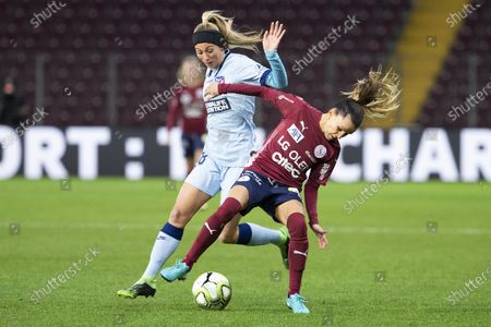 Atletico Madrid's forward Toni Duggan, left, fights for the ball with Servette's defender Amandine Soulard, right, during the UEFA Women's Champions League, Round of 32 first leg soccer match between Servette FC Chenois Feminin and Atletico Madrid, in Geneva, Switzerland, 09 December 2020.