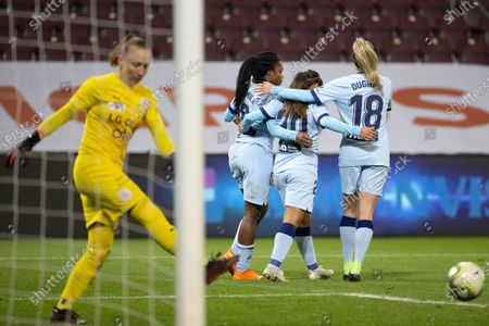 (L-R) Atletico Madrid's forward Ludmila Da Silva celebrates with teammates Leicy Santos and Toni Duggan after scoring the 1-1 during the UEFA Women's Champions League, Round of 32 first leg soccer match between Servette FC Chenois Feminin and Atletico Madrid, in Geneva, Switzerland, 09 December 2020.