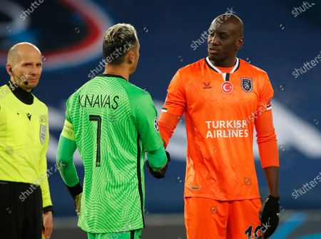 Stock Picture of Basaksehir's Demba Ba, right, shakes hands with PSG's goalkeeper Keylor Navas after the Champions League group H soccer match between Paris Saint Germain and Istanbul Basaksehir at the Parc des Princes stadium in Paris, France