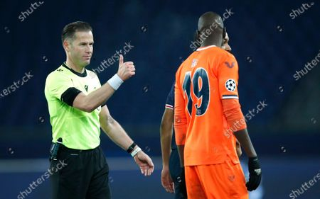 Referee Danny Makkelie gives a thumbs up to Basaksehir's Demba Ba after the Champions League group H soccer match between Paris Saint Germain and Istanbul Basaksehir at the Parc des Princes stadium in Paris, France