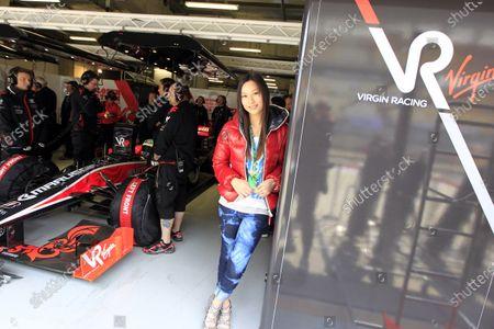 Stock Picture of Shanghai International Circuit, Shanghai, China 16th April 2010 Former Miss Hong Kong Kate Tsui in the Virgin garage. Portrait. VIPs. World Copyright: Glenn Dunbar/LAT Photographic