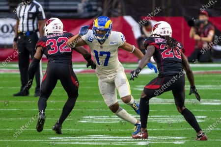 Los Angeles Rams wide receiver Robert Woods (17) in action against Arizona Cardinals strong safety Budda Baker (32) and cornerback Dre Kirkpatrick (20) during an NFL football game, in Glendale, Ariz