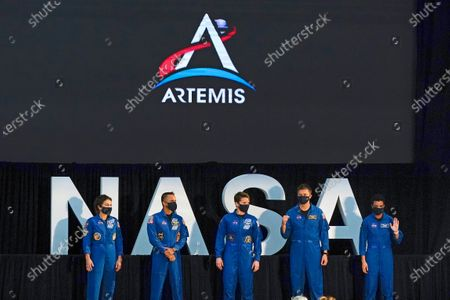 Stock Picture of Five of the astronauts that will be part of the Atremis missions, from left, Jessica Meir, Joe Acaba, Anne McClain, Matthew Dominick, and Jessica Watkins are introduced by Vice President Mike Pence during the eighth meeting of the National Space Council at the Kennedy Space Center, in Cape Canaveral, Fla