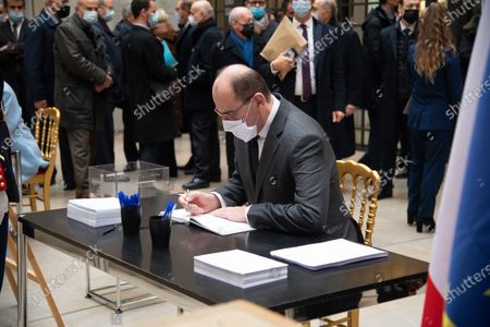 French Prime Minister Jean Castex signs the guest book for late former French President Valery Giscard d'Estaing at the Musee d'Orsay in Paris on the national day of mourning for the former president. Valery Giscard d'Estaing died from Covid-19 aged 94, surrounded by his family on December 2 at the family estate. Giscard governed for a single seven-year term from 1974 to 1981.