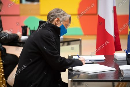 French Labour Minister Elisabeth Borne signs the guest book for late former French President Valery Giscard d'Estaing at the Musee d'Orsay in Paris on the national day of mourning for the former president. Valery Giscard d'Estaing died from Covid-19 aged 94, surrounded by his family on December 2 at the family estate. Giscard governed for a single seven-year term from 1974 to 1981.