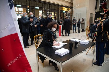 Emmanuelle Wargon signs the guest book for late former French President Valery Giscard d'Estaing at the Musee d'Orsay in Paris on the national day of mourning for the former president. Valery Giscard d'Estaing died from Covid-19 aged 94, surrounded by his family on December 2 at the family estate. Giscard governed for a single seven-year term from 1974 to 1981.