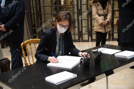 Amelie de Montchalin signs the guest book for late former French President Valery Giscard d'Estaing at the Musee d'Orsay in Paris on the national day of mourning for the former president. Valery Giscard d'Estaing died from Covid-19 aged 94, surrounded by his family on December 2 at the family estate. Giscard governed for a single seven-year term from 1974 to 1981.