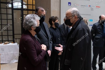 President of the French Constitutional Council Laurent Fabius greets Valery Giscard d'Estaing's widow Anne-Aymone (C) and her son Henri Giscard d'Estaing (2nd-L) as he arrives to sign the guest book for late former French President Valery Giscard d'Estaing at the Musee d'Orsay in Paris on the national day of mourning for the former president. Valery Giscard d'Estaing died from Covid-19 aged 94, surrounded by his family on December 2 at the family estate. Giscard governed for a single seven-year term from 1974 to 1981.