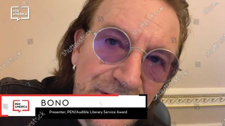 Bono presenting the Audible Literary Service Award to Patti Smith.