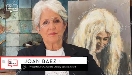 Stock Picture of Joan Baez presenting the Audible Literary Service Award to Patti Smith.