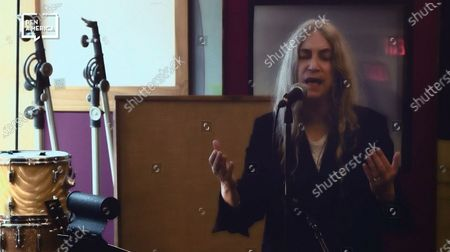 Stock Photo of Patti Smith performing after accepting her award.