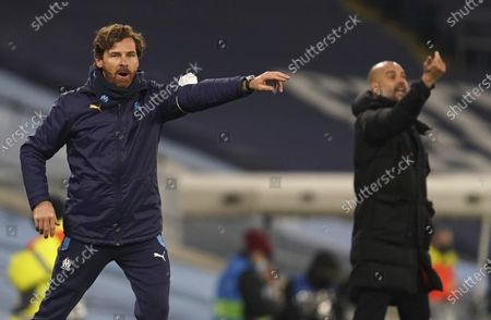 Marseille's head coach Andre Villas-Boas, left, and Manchester City's head coach Pep Guardiola give instructions from the side line during the Champions League, Group C, soccer match between Manchester City and Marseille at the Etihad stadium in Manchester in London