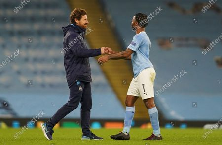 Marseille's head coach Andre Villas-Boas, left, cheers Manchester City's Raheem Sterling end of the Champions League, Group C, soccer match between Manchester City and Marseille at the Etihad stadium in Manchester in London . Manchester City won 3-0