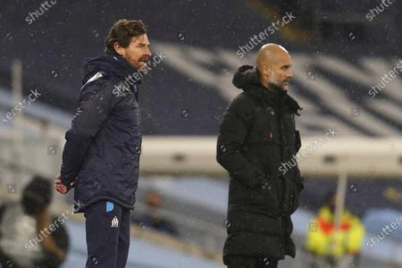 Marseille's head coach Andre Villas-Boas, left, and Manchester City's head coach Pep Guardiola stand on the touchline during the Champions League, Group C, soccer match between Manchester City and Marseille at the Etihad stadium in Manchester in London