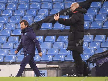 Manchester City's manager Pep Guardiola (R) and Olympique Marseille's manager Andre Villas Boas (L) during the UEFA Champions League group C soccer match between Manchester City and Olympique Marseille in Manchester, Britain, 09 December 2020.