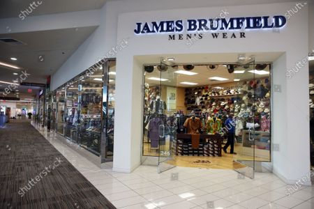 A person shops inside James Brumfield Men's Wear in Baldwin Hills Crenshaw Plaza on Tuesday, Dec. 8, 2020 in Los Angeles, CA. The Baldwin Hills mall is on the market and has very low visitors each day. (Dania Maxwell / Los Angeles Times)