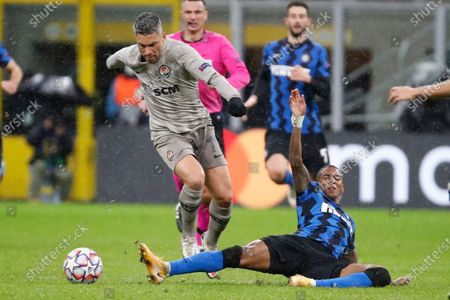 Shakhtar's Marlos, left, is tackled by Inter Milan's Ashley Young during the Champions League group B soccer match between Inter Milan and Shakhtar Donetsk at the San Siro stadium in Milan, Italy