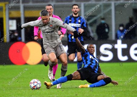 Donetsk's Marlos (L) in action against Inter's Ashley Young (R) during the UEFA Champions League group B soccer match between Inter Milan and Shakhtar Donetsk in Milan, Italy, 09 December 2020.