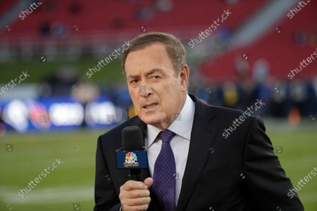 Al Michaels, play-by-play voice for NBC's Sunday Night Football, works on the sideline before an NFL game between the Los Angeles Rams and the Seattle Seahawks, in Los Angeles. Former ABC baseball commentator Al Michaels has been voted the Ford C. Frick Award for broadcast excellence by baseball's Hall of Fame. Michaels, 76, will be honored during the Hall of Fame induction weekend in July